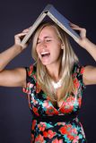 Screaming woman with book Royalty Free Stock Photography