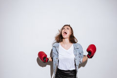 Screaming woman boxer over white background Stock Images