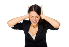 Screaming woman covering ears. Royalty Free Stock Image