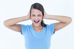 Screaming woman covering her ears Stock Photos
