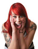 Screaming Woman With Hands on Face. Screaming woman with red hair leaning forward Royalty Free Stock Photo