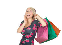 Screaming woman keeping coloured shopping bags Royalty Free Stock Photos