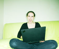 Screaming woman with laptop Stock Images