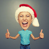 Screaming woman in santa hat Royalty Free Stock Photography