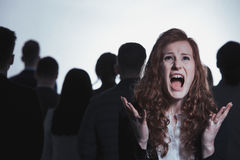 Screaming woman standing in crowd. Screaming woman standing in anonymous crowd of people Stock Photos
