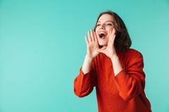 Screaming woman standing isolated over blue background. Photo of screaming woman standing isolated over blue background looking aside Royalty Free Stock Photography