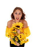 Screaming woman with sunflowers. Stock Images