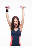 Screaming woman working out with dumbbells Royalty Free Stock Photos