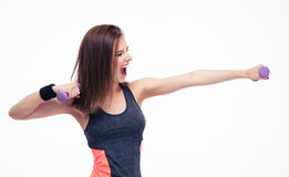 Screaming woman workout with dumbbells Stock Photos