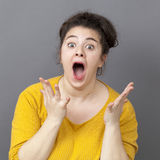Screaming xxl girl with yellow sweater Royalty Free Stock Photography