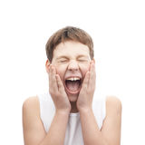 Screaming young boy in a sleeveless shirt Stock Photography
