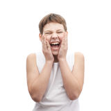 Screaming young boy in a sleeveless shirt. Screaming young boy in a sleeveless white shirt putting on an after shave lotion, composition isolated over the white Royalty Free Stock Photo