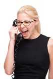 Screaming young business woman with telephone Royalty Free Stock Photography