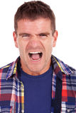 Screaming young casual man Stock Photo