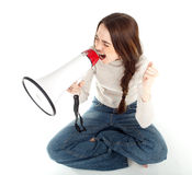 Screaming young girl with megaphone Stock Image
