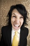 Screaming young man. In a business suit and tie Royalty Free Stock Photography