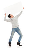 Screaming young man with a banner. Young man holding a banner and screaming. Full length studio shot isolated on white Stock Image