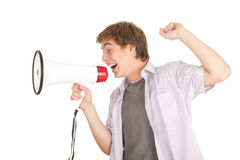 Screaming young man holding megaphone. White background Stock Image