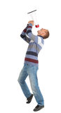 Screaming young man holding megaphone. White background Royalty Free Stock Photography