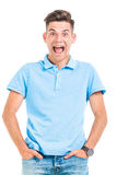 Screaming young man looking at the camera. While holding his hands in pockets Royalty Free Stock Image