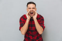 Screaming young man looking at camera. Stock Images