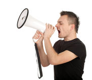 Screaming young man with megaphone Stock Photos