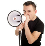 Screaming young man with megaphone Royalty Free Stock Photos