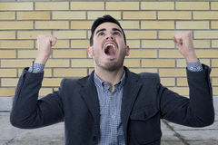 Screaming young man. Modern screaming young man, business concepts Royalty Free Stock Photos
