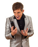 Screaming young man with phone Stock Photo