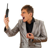 Screaming young man with phone Royalty Free Stock Image