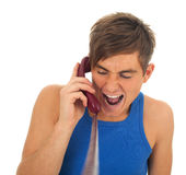 Screaming young man with phone Royalty Free Stock Images