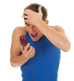 Screaming young man with phone Stock Images