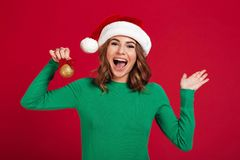 Screaming young pretty woman holding christmas tree toys decorations. Stock Image