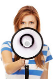 Screaming young teenage woman with megaphone Stock Images