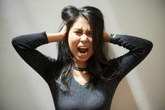 Screaming young Vietnamese woman royalty free stock photography