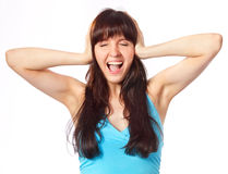 Screaming young woman holding head Royalty Free Stock Photography