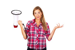 Screaming young woman holding megaphone and gesturing dont know Stock Photo