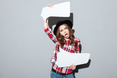 Screaming young woman holding speech bubble. Stock Photos