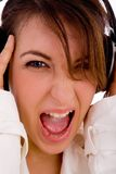 Screaming young woman listening music Royalty Free Stock Photos