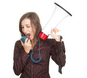 Screaming young woman with megaphone Stock Photography