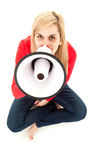 Screaming young woman with megaphone Royalty Free Stock Images
