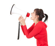 Screaming young woman with megaphone Stock Photo