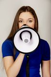 Screaming young woman with megaphone. Stock Photo