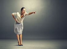Screaming young woman pointing Stock Photo