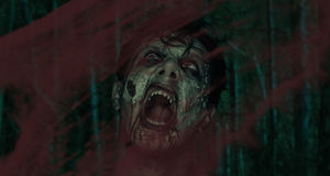 Screaming zombie. Screaming horrible zombie behind a bloody glass, Halloween or horror theme Stock Photos