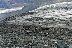 Scree and rock debris covering the glacier Hohlaubgletscher Stock Images