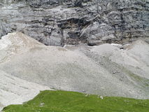 Scree slopes at rock wall stock photography