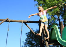 Screeming girl - step to nowhere. Screeming and shouting little girl - barefoot kid jumping from a slide and flying Royalty Free Stock Photography