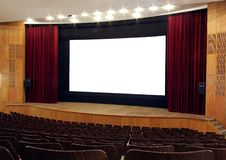 The screen. Cinema; wooden walls and chairs, red velvet curtain, white empty screen Stock Photo