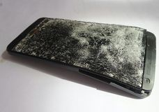 Screen broken and damage mobile phone. Broken and scratching screen after fall on floor stock photos